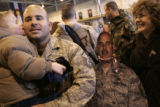 [316] Pedro Mendoza III, 4, kisses his dad Master Sgt. Peter Mendoza after he arrived to Buckley...