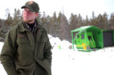 Brian Verhulst, a Forest Health Biologist, talks in front of the park's air curtain at Glacier...
