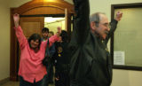 Family members cheer after hearing Tim Masters was now free of the prison system at the Larimer...