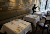 VAIL - Sweet Basil restaurant server Nikki Rundle checks wine and water glass setups from the...
