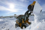 Jeremiah Coey (cq) clears snow from around a building in Bayfield, Colo., on Thursday, February 7,...