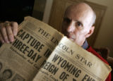 Del Harding's holds a copy of the Lincoln Star from Thursday January 20, 2008 announcing the...