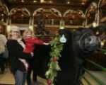 Carolyn Rapp (cq),left, and her daughter Glenna Rapp, look at Maynard, the steer, in the Brown...