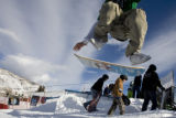 DM2353   Russ Tebaldi, 17, of Aspen leaps onto his board in the Snowskate at the base of...