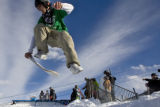 DM2369   Russ Tebaldi, 17, of Aspen leaps onto his board in the Snowskate at the base of...