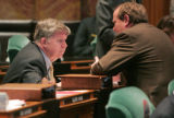 Douglas Bruce R-Colorado Springs, left, confers with Mike May  R- Parker before the beginning of...