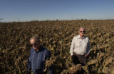 Brothers Paul Hopp, 64 and Conrad Hopp, 68, stand on what was once their family farm, and also...