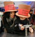 11 - Lauren Carrion, 18, left, and her brother Nicasio Guzman, 8, both from New York City, try...