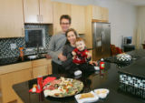 Christa and Brad Tomecek, and their son, Austin, 15 months in the kitchen of their new prefab...