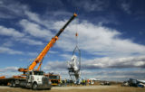 Construction workers install the Mustang sculpture at DIA on Monday, February 11, 2008. The...