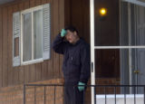 Investigator Frank Negley wipes his brow as he and local and state investigators poured over...