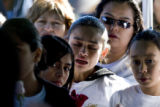 DM0292   Tears stream down the face of Maria Ceniceros, 11, center, during the burial of her...