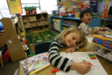 MJM077  Ralston Elementary School student, Raine Lee-Findling, 5, center, works along with...