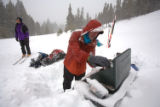 (Leadville, Colo., Jan. 5, 2008) Sandee Miller, looking for racers, and Jon McManus, at the stove...