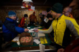 (Leadville, Colo., Jan. 5, 2008) Lexi Miller, left, helps with registration.  The 19th annual...