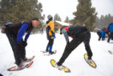 (Leadville, Colo., Jan. 5, 2008) Mark and Travis (son) Macy, from Golden, warm up at the...