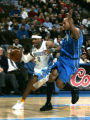 Denver Nuggets Allen Iverson, left, drives to the basket against the Orlando Magic at the Pepsi...
