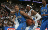 [ JPM0169 ] Denver Nuggets Carmelo Anthony tries to slip past Orlando Magic Keith Bogans, left, as...