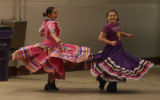Jordan Lopez, left, and Mariah Kittrell practice their moves during rehearsal for the Mexican...