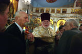 Archpriest Joseph Hirsch has follower kiss the cross during the Divine Liturgy and Slava Service...