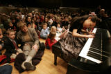 [157] Vivian Tang (cq), 7, from Broomfield, performs Haydn's Piano Concerto in C for a huge crowd...