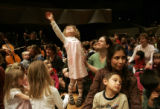 [130] Jahan Anderson, 3, dances to music that Tom Jensen (cq), the music director and conductor...