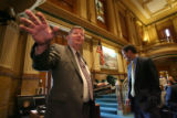 (at left) Republican Rep. Douglas Bruce (cq) from Colorado Springs talks to reporters after being...