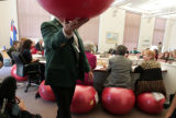 Sergeant-At-Arms Keith Dameron carries an exercise ball form the committee floor as State...