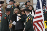Friends and family of Major Andrew Olmsted, leave the Soldier's Memorial Chapel in Fort Carson, at...