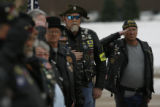 Members of the Patriot Guard Riders salute the casket of Major Andrew Olmsted, who died in an...