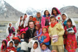 can you please put the attached  photo in scc (the photo where he is surrounded by children in...