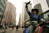 Ali Nazarenus, the U.S. Marshal Posse Queen,16 from Brighton, CO  waves to the crowd as she rides...