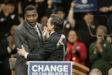 [614] Rod Smith, a Denver Bronco, is greeted by Federico Pena before Barack Obama addressed a huge...