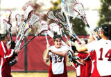 Denver University Pioneers Lacrosse player , #13 Karen Morton, runs through her teammates as her...