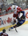 DM0776  Detroit Red Wings Brett Lebda #22 knocks Colorado AvalancheAndrew Brunette #15 off his...