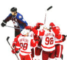 DM0496  Colorado Avalanche team captain Joe Sakic skates past the Detroit Red Wings as they...