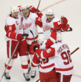 DM0489  Detroit Red Wings celebrate a goal by Pavel Datsyuk #13, center looking up smiling, his...