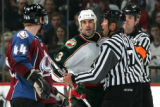 BG0352 Colorado Avalanche #44 Jordan Lepold stands his ground as  Minnesota Wild #3 Keith Carney...