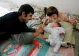 Islom Khalidov, left, and his daughters, Sabrina Khalidova, 4, and one-month-old Aeda Khalidova...