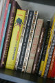 A collection of books--many of them about clowns, magic, comedy, and circuses--in the home of...