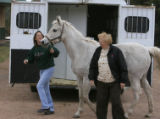 DM5614  Roni and Tracy Vale unload Midnight, one of 10 horses they had to evacuate from their...