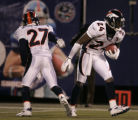 Darrent Williams celebrates with Champ Bailey after Bailey's interception during the fourth...