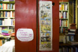 Handmade signs mark sections of books at West Side Books on 32nd street in Highland square on...