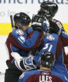 DM0032  Colorado Avalanche captain Joe Sakic embraces goalie Peter Budaj after losing 8-2 to the...