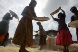 A group of women workers clean corn at Project Mercy in Yetebon, Ethiopia on, Saturday, October 1,...