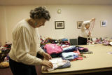 Ruth Klein (cq) sorts through donated clothing while fellow volunteer Nancy Woodward does the same...