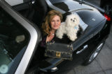 Ivette Dominguez, president of Alpine GMC in Littleton, sits in a 2008 convertible Pontiac...