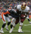 JPM1073 Denver Broncos Sam Brandon, #42, hits Washington Redskins halfback Mike Sellers in the end...