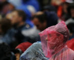 JPM001 A fan at the Denver Broncos-Washington Redskins game watches the action from a poncho at...