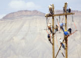 PHOTO SPECIAL TO THE ROCKY MOUNTAIN NEWS GRAND JUNCTION - Linemen from the region's public and...